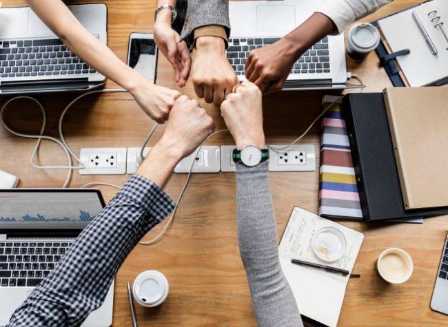 colleagues-giving-fist-bump-min